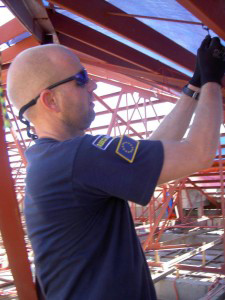 RescueNet worker repairs town hall roof