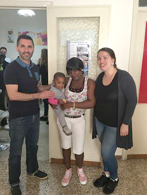 In Sicily, Francesco and Tina Luzzolini assist a refugee who gave birth on the boat